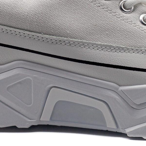 Sneakers de tela con puntera y base ancha